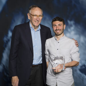 Damiano Cerrone accepting his ESRI Young Scholar Award in San Diego
