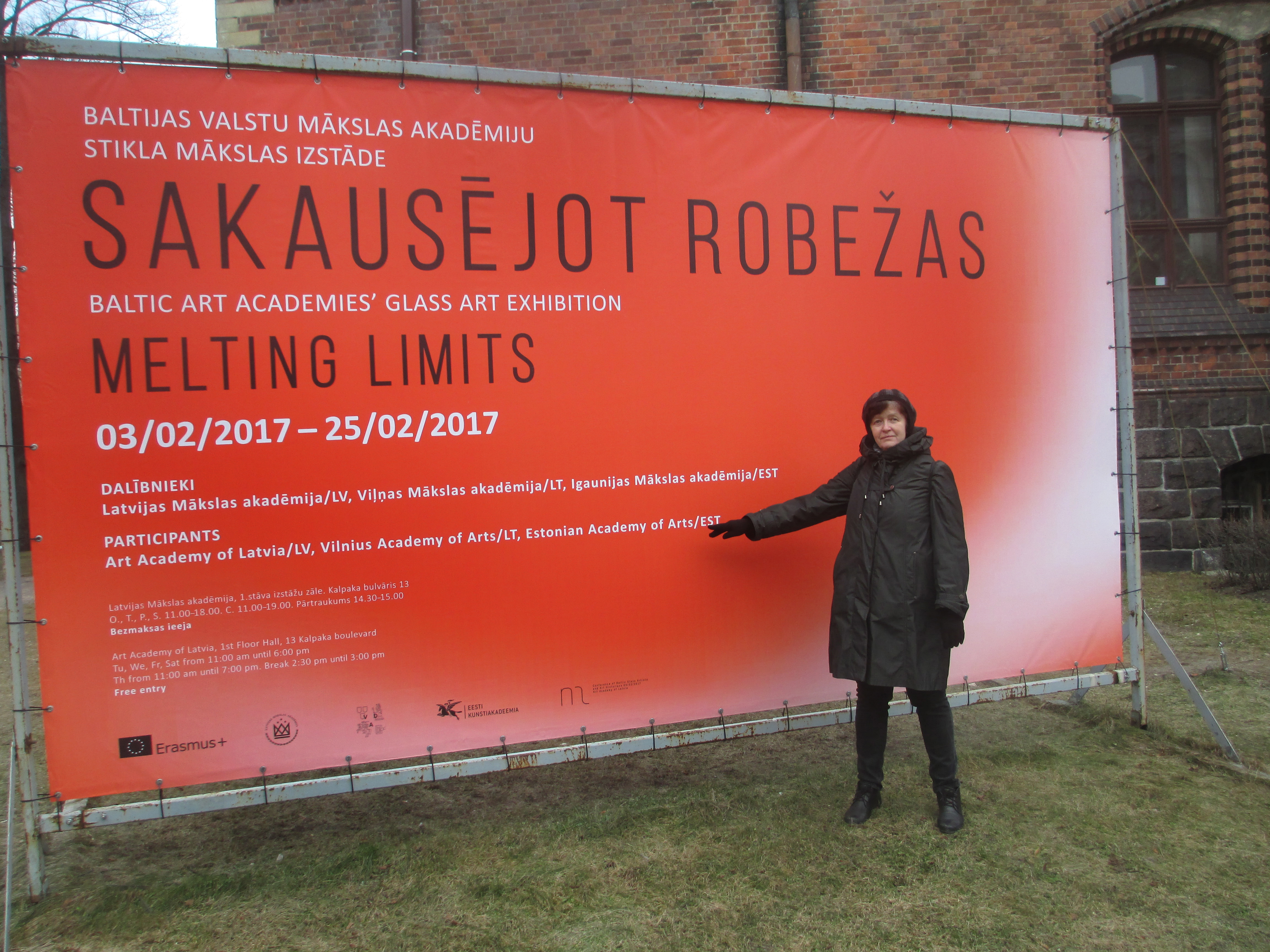 Professor Mare Saare from the Department of Glass Art with the exhibition banner
