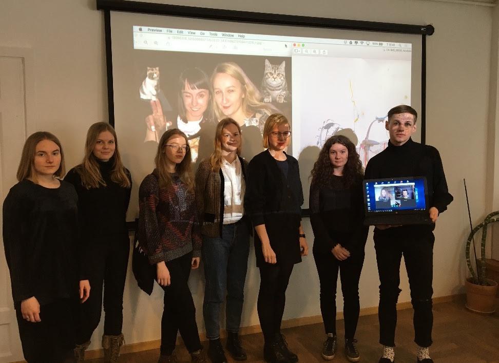 Interns at the briefing (from the left): Lill Volmer, Saskia Epp Lõhmus, Darja Jefimova, Mari-Liis Vanem, Einike Leppik, Carol Piibur, Tauri Västrik, Liisa Rõžikova and Aap Kirsel (the last two on Skype) pose with a picture of Katja Novitskova and Kati Ilves.